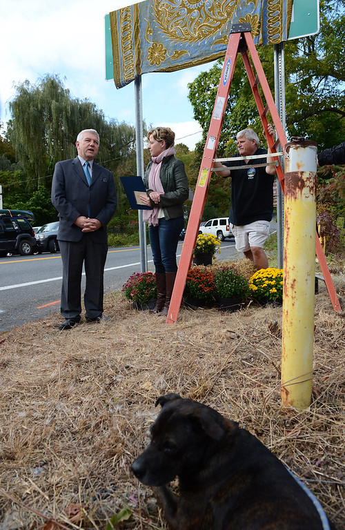 Description of . Even Muddy, Levon Helm's dog was at the unveiling  Friday. In the rear Assemblyman Kevin Cahill says a few words standing next to Amy Helm, Levon's daughter before the unveiling.