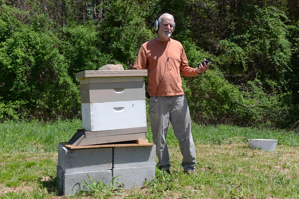 Description of . Tania Barricklo-Daily Freeman Jim Metzner uses a contact microphone, or transducer which uses vibration,  on his beehive to listen to his bees wortking inside.