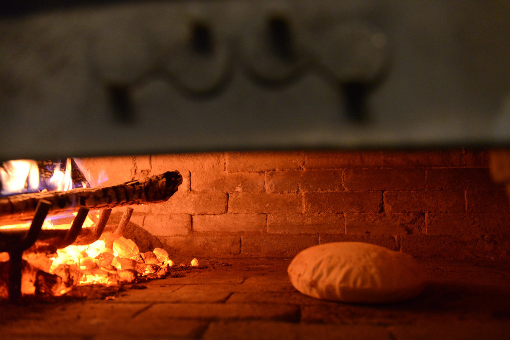 Description of . Tania Barricklo-Daily Freeman Bread rises in the wood -fired oven at La Florentina.