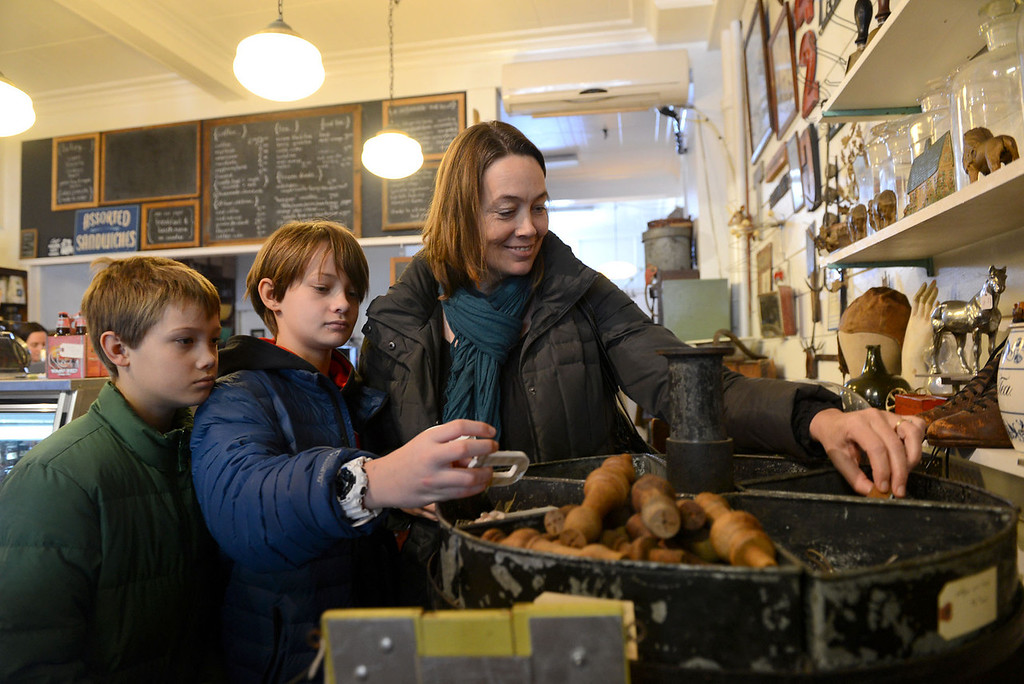 Description of . Tania Barricklo-Daily Freeman  Carol Murray of Rifton looks around the Outdated Cafe with her sons Evan, 10, left, and Ben, 11, while vsiting the establishment during a snow day in Kingston. The cafe is decorated with antique items from multiple decades , all of which are for sale.