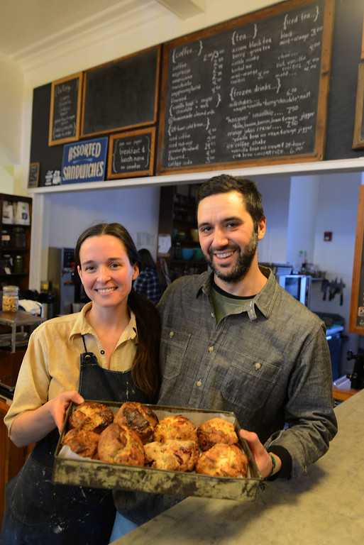Description of . Tania Barricklo-Daily Freeman  Tarah Gay and Gabriel Constantine, co-owners of the Outdated Cafe on Wal St. in KIngston, hold out a tray of an assortment of biscuits and scones.