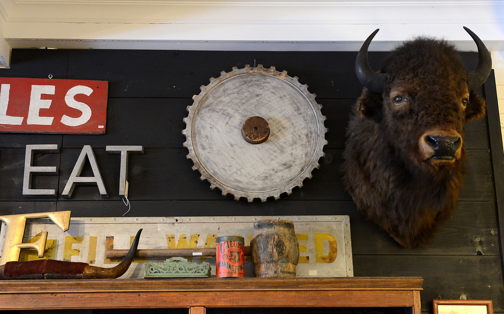 Description of . Tania Barricklo-Daily Freeman  The wals at he Outdated Cafe are covered with any number of unusual items, including this bison head.