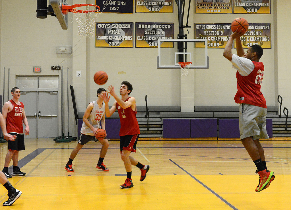 Description of . Tania Barricklo-Daily Freeman                      Tim Terry, right, takes a shot during practice.