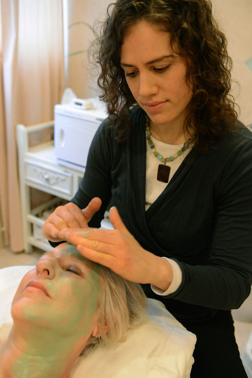 Description of . Tania Barricklo-Daily Freeman Natie Kwait, a licensed esthetician at Rver Rock, demonstrates a facial on Joyce Beymer Allenby.