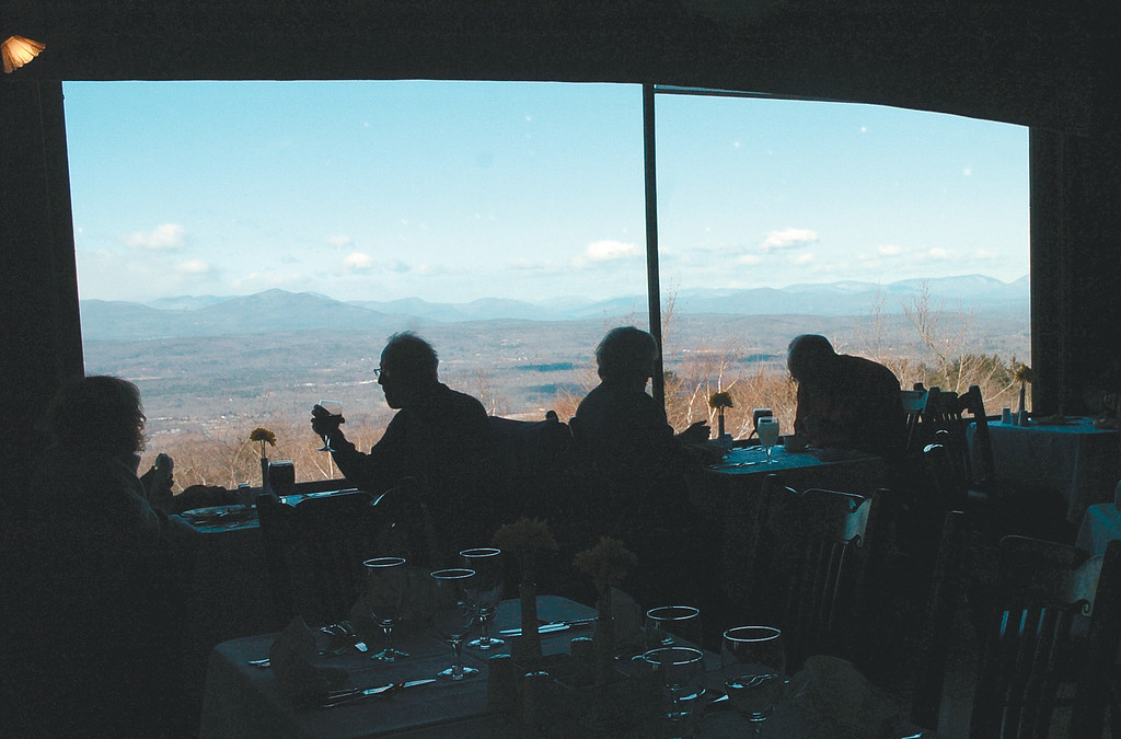 Description of . Diners enjoy the view with their lunch  in the main dining hall at Mohonk Mountain House in January 2013.