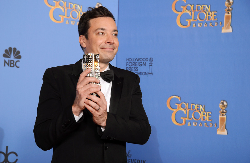 Description of . Jimmy Fallon poses in the press room at the 71st annual Golden Globe Awards at the Beverly Hilton Hotel on Sunday, Jan. 12, 2014, in Beverly Hills, Calif. (Photo by Jordan Strauss/Invision/AP)