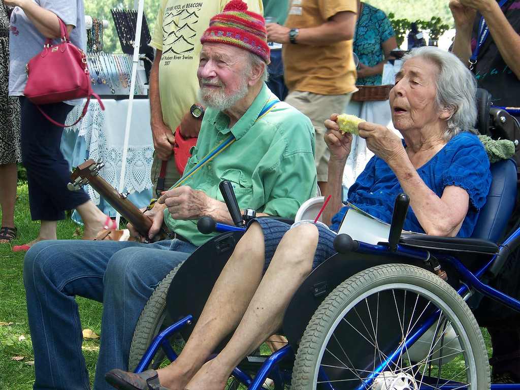 Description of . Pete Seeger and wife Toshi at the Beacon Riverside Park Fall Festival in 2012. William Marchetti photo.