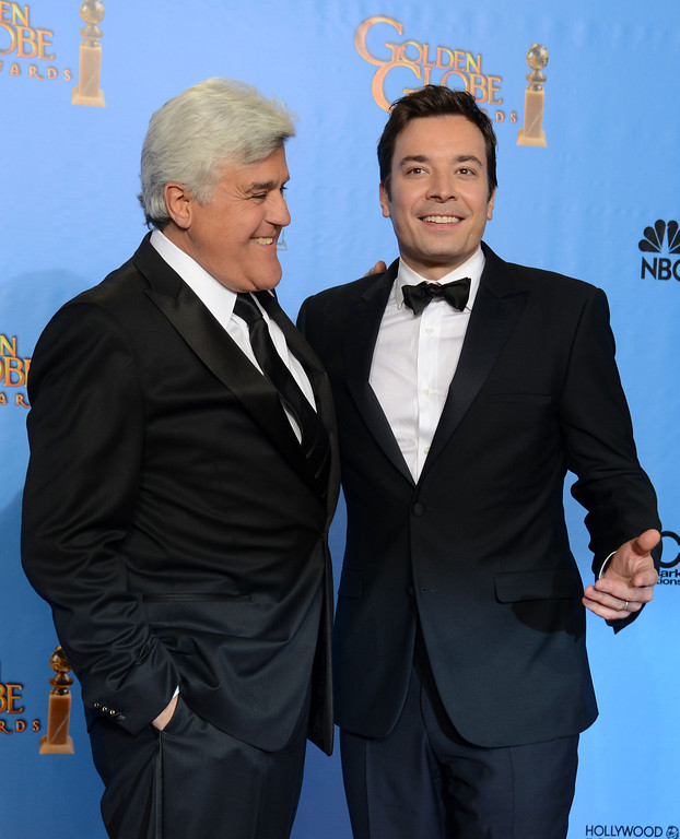 Description of . File- This Jan. 13, 2013, file photo shows presenters Jimmy Fallon, left, and Jay Leno posing backstage at the 70th Annual Golden Globe Awards at the Beverly Hilton Hotel  in Beverly Hills, Calif. Leno will close out his 22-year run as host of NBC's
