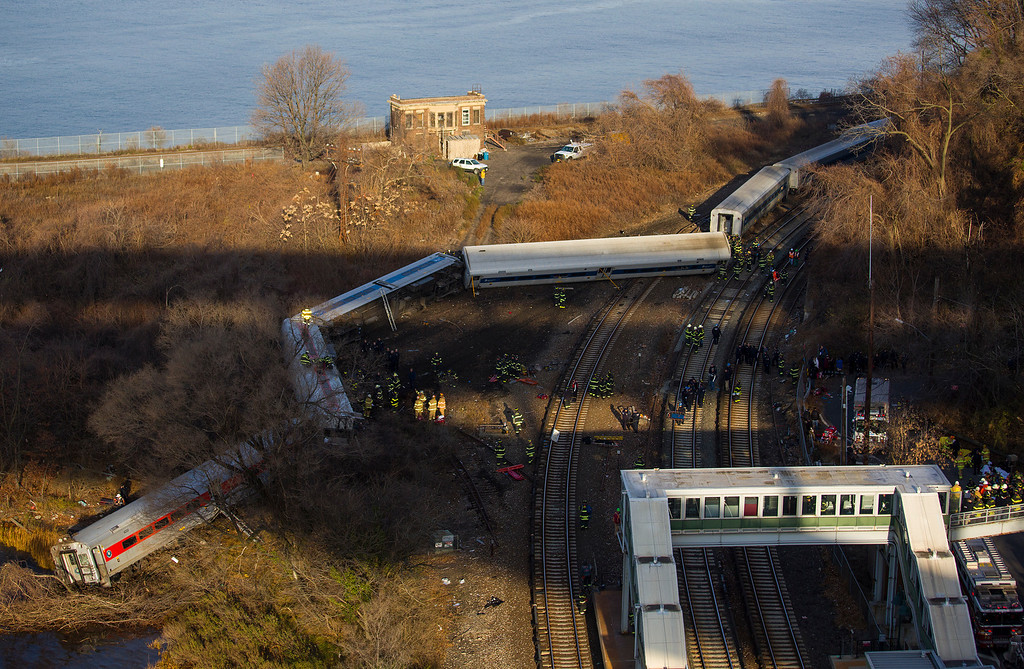 Description of . First responders gather around the derailment of a Metro North passenger train in the Bronx borough of New York Dec. 1, 2013  The Fire Department of New York says there are