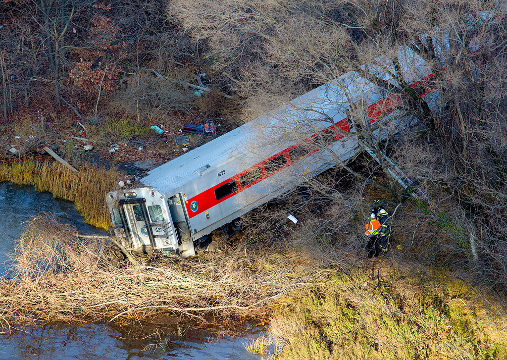 Description of . First responders view the derailment of a Metro North passenger train in the Bronx borough of New York Dec. 1, 2013. The Fire Department of New York says there are