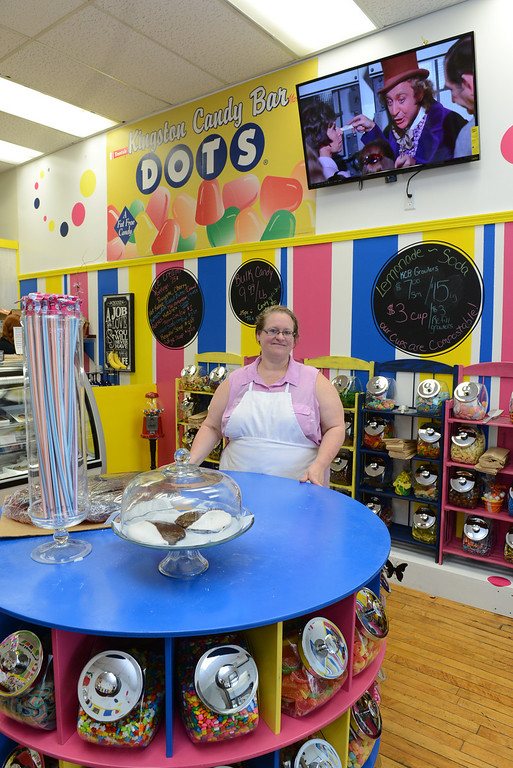 Description of . Tania Barricklo-Daily Freeman Diane Reeder , owner of Kingston Candy Bar, stands in her newly openend store at 319 Wall St in uptown Kingston.