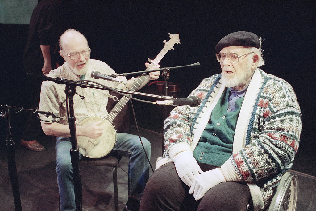 Description of . File-This May 1993 file photo shows Pete Seeger, left, age 74, who hadn't sung with Burl Ives, right, age 84, for at least 40 years, singing together in rehearsal at New York's 92nd St., Y.   The American troubadour, folk singer and activist Seeger  died Monday Jan. 27, 2014, at age 94.  (AP Photo/Marty Reichenthal, File)