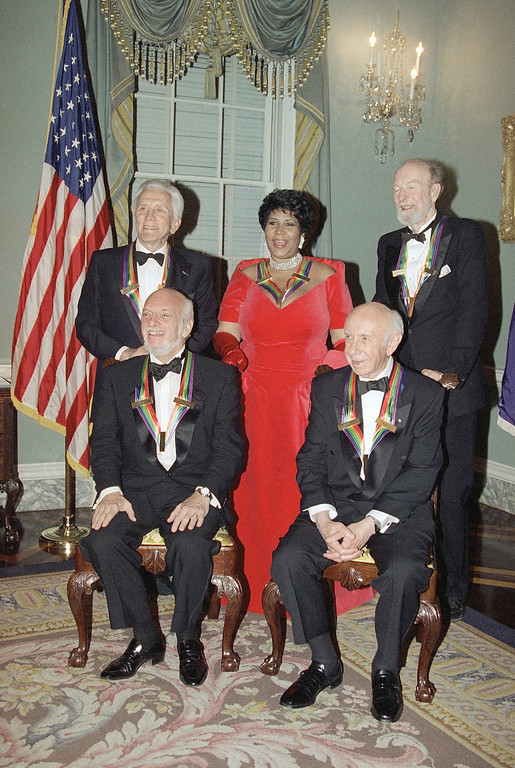 Description of . File- This 1994 file photo shows actor Kirk Douglas, standing from left, singer Aretha Franklin, singer Peter Seeger and seated from left, director Harold Prince and composer Morton Gould pose for photographers on Saturday, Dec. 3, 1994 following a dinner at the State Department in Washington. The dinner was to honor them as recipients of the Kennedy Center Honors of 1994.  The American troubadour, folk singer and activist Seeger  died Monday Jan. 27, 2014, at age 94. (AP Photo/Doug Mills, File)