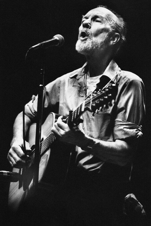 Description of . File- This Feb. 25, 1984, file photo shows folk singer Pete Seeger  performing in a one-man benefit concert in Berkeley, Calif., at the Berkeley Community Theater. The American troubadour, folk singer and activist Seeger  died Monday Jan. 27, 2014, at age 94. (AP Photo/Mark Costantini, File)