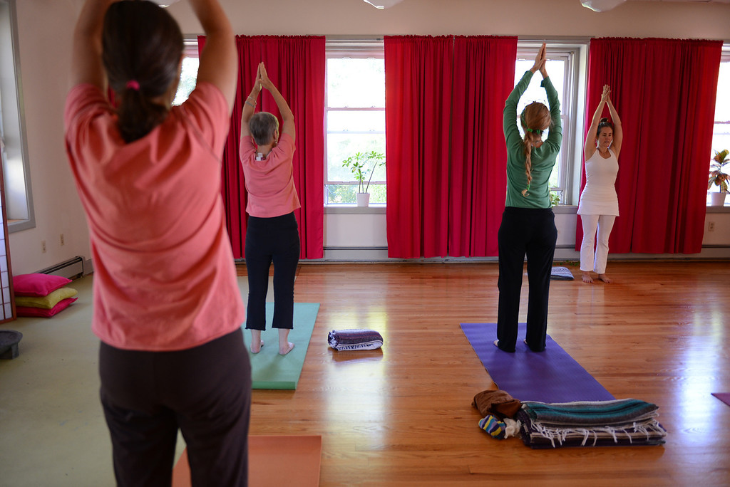 Description of . Tania Barricklo-Daily Freeman Shawn Harrison of Mudita Yoga at 243  Fair St.  in Kingston leads a morning yoga class.