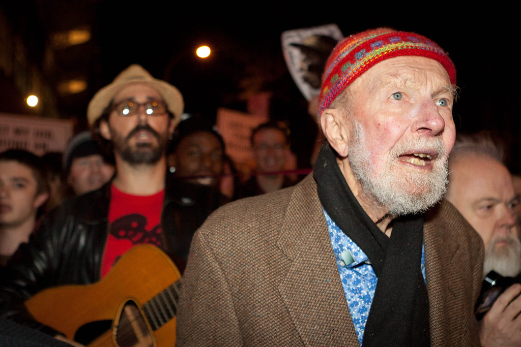 Description of . File-This Oct. 21, 2011, file photo shows activist musician Pete Seeger, 92, left, marches with nearly a thousand demonstrators sympathetic to the Occupy Wall Street protests for a brief acoustic concert in Columbus Circle in New York.    The American troubadour, folk singer and activist Seeger  died Monday Jan. 27, 2014, at age 94.  (AP Photo/John Minchillo, File)