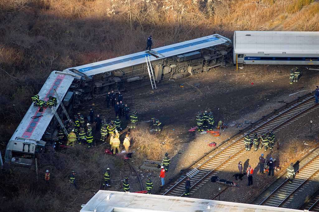 Description of . First responders gather at the derailment of a Metro North passenger train in the Bronx borough of New York Dec. 1, 2013  The Fire Department of New York says there are