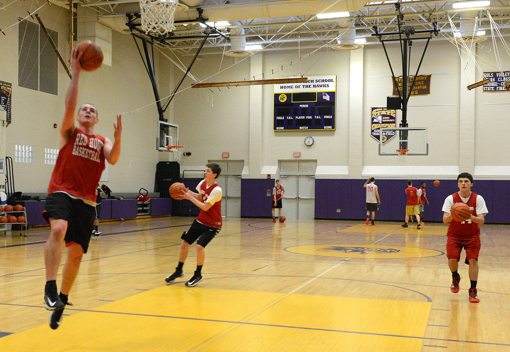 . Tania Barricklo-Daily Freeman                      Nolan Dalton does a layup Tucker Griffin, center, and Nick D\'Angelo , right.
