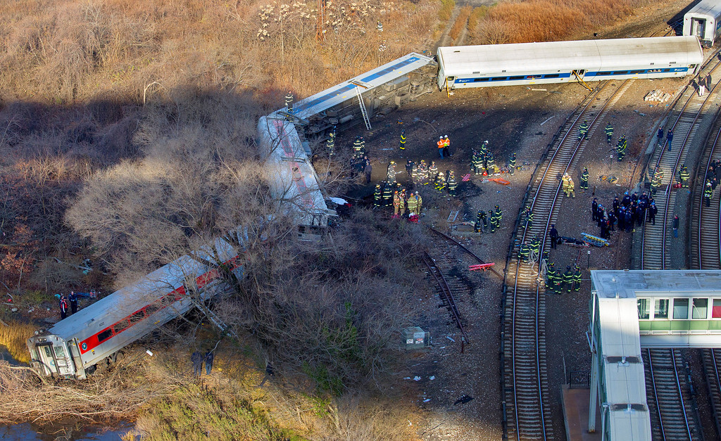 ". First responders gather at the derailment of a Metro North passenger train in the Bronx borough of New York Sunday, Dec. 1, 2013  The Fire Department of New York says there are ""multiple injuries\"" in the  train derailment, and 130 firefighters are on the scene. Metropolitan Transportation Authority police say the train derailed near the Spuyten Duyvil station. (AP Photo/Craig Ruttle)"