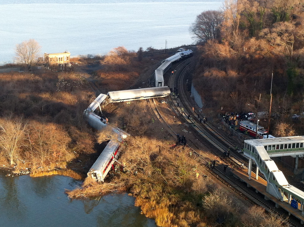 ". Cars from a Metro-North passenger train are scattered after the train derailed in the Bronx neighborhood of New York, Sunday, Dec. 1, 2013. The Fire Department of New York says there are ""multiple injuries\"" in the  train derailment, and 130 firefighters are on the scene. Metropolitan Transportation Authority police say the train derailed near the Spuyten Duyvil station. (AP Photo/Edwin Valero)"