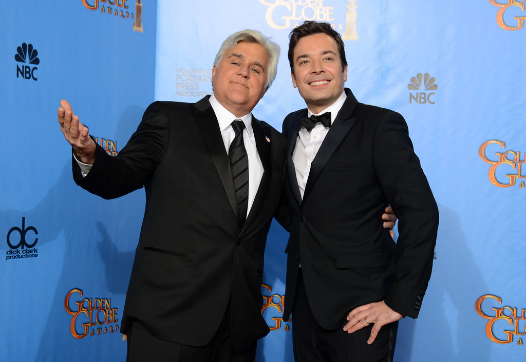 """. FILE - This Jan. 13, 2013 file photo shows Jay Leno, host of \""""The Tonight Show with Jay Leno,\"""" left, and Jimmy Fallon, host of \""""Late Night with Jimmy Fallon\"""" backstage at the 70th Annual Golden Globe Awards in Beverly Hills, Calif. On Thursday, Feb. 6, 2014, Leno, 63, is stepping down for the second and presumably last time, making way for his successor, Fallon, in New York. Fallon, 39, starts his \""""Tonight Show\"""" on Feb. 17, with NBC hoping he rides the promotional wave of its Winter Olympics coverage. (Photo by Jordan Strauss/Invision/AP, file)"""