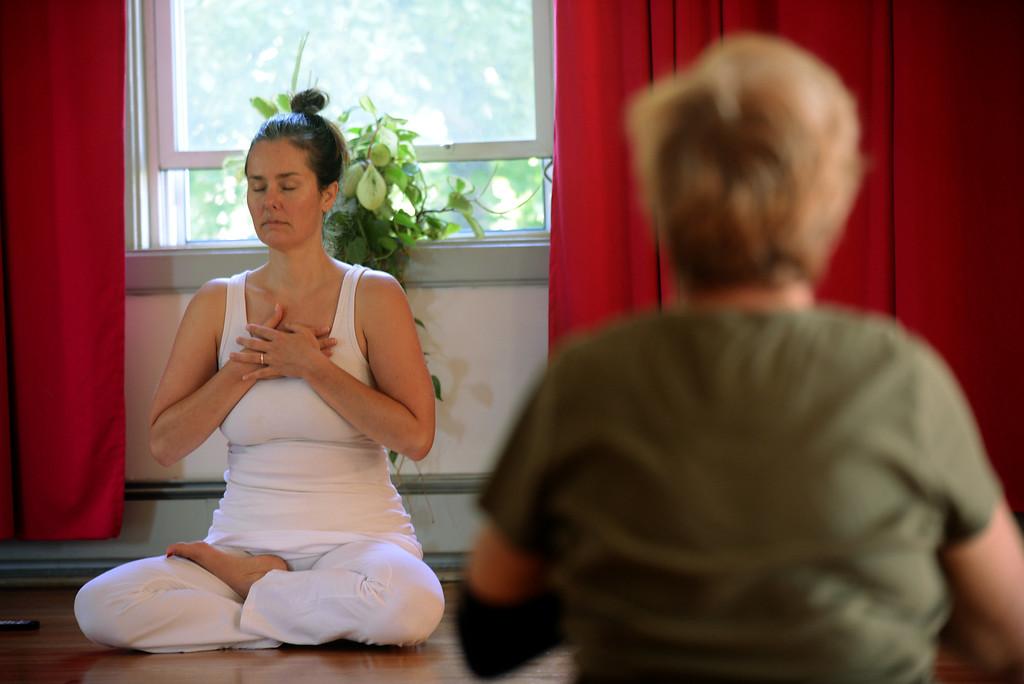 . Tania Barricklo-Daily Freeman Shawn Harrison of Mudita Yoga in Kingston leads a morning class.