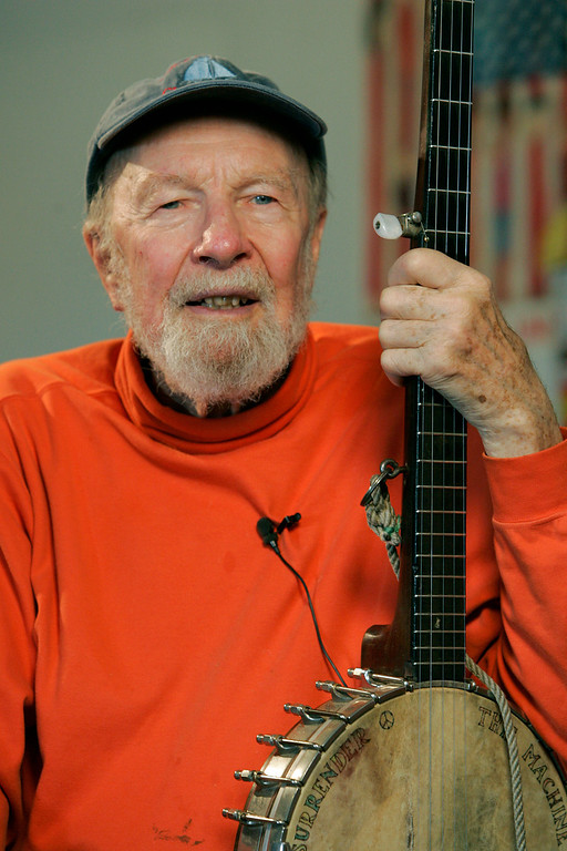 """. File- This May 5, 2006, file photo shows Pete Seeger in Beacon, N.Y. The earnest troubadour who either co-wrote or popularized canonical songs like \""""If I Had a Hammer\"""" and \""""John Henry\"""" has become something like America\'s folkie emeritus. He\'s back on the charts now, sort of, with the release of \""""We Shall Overcome: The Seeger Sessions,\"""" featuring Bruce Springsteen\'s full-throated versions of standards performed by Seeger.   The American troubadour, folk singer and activist Seeger  died Monday Jan. 27, 2014, at age 94.  (AP Photo/Frank Franklin II, File)"""