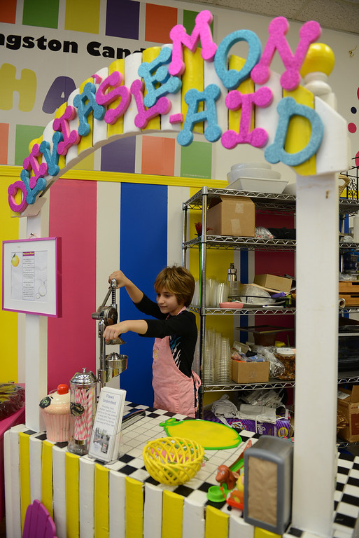 . Tania Barricklo-Daily Freeman Reeder\'s daughter Olivia,9, has her very own lemonade stand in the Kingston Candy Bar at the newly openend store at 319 Wall St in uptown Kingston.